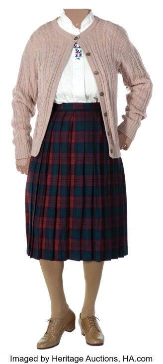 A cardigan, blouse, and skirt.
