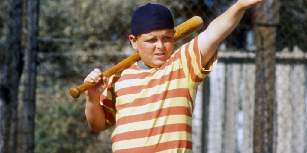 A boy lifts his arm.